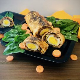 Puff pastry mince roll with boiled eggs